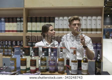KIEV, UKRAINE - NOVEMBER 21, 2015: Andy Bell, Regional Sales Manager, presents The Arran Single Malt Scotch Whisky distillery booth at 1st Ukrainian Whisky Dram Festival in Parkovy Exhibition Center. - stock photo