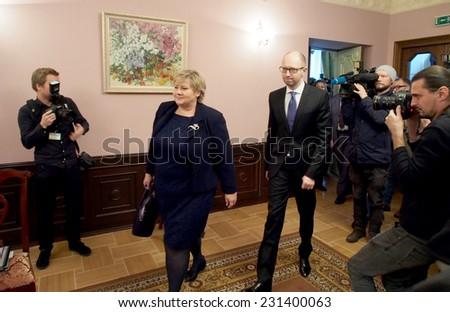 KIEV, UKRAINE - November 18, 2014: PM Arseniy Yatsenyuk and Prime Minister of Norway signed the Agreement between the Government of Ukraine and the Government of the Kingdom of Norwa - stock photo