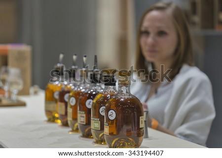 KIEV, UKRAINE - NOVEMBER 21, 2015: Unrecognized presenter works on The Glenrothes Speyside Single Malt Scotch Whisky distillery booth at 1st Ukrainian Whisky Dram Festival in Parkovy Exhibition Center - stock photo