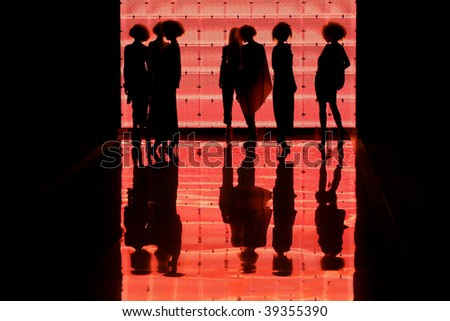 "KIEV, UKRAINE - OCT 15: Silhouette of models on the runway during Fashion Show by ""GROMOVA DESIGN"" as part of Ukrainian Fashion Week, October 15, 2009 in Kiev, Ukraine. - stock photo"