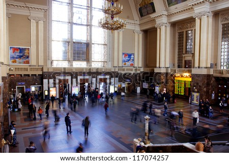 KIEV, UKRAINE - OCTOBER 27: Crowd of busy people inside the building of Central Railway Station on October 27, 2012 in Kiev, Ukraine. Kiev's Central Railway Station serving 170,000 passengers per day. - stock photo
