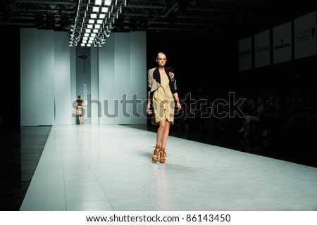 "KIEV, UKRAINE - OCTOBER 16: Fashion model wears clothes created by ""ANNA BUBLIK"" at the 24th Ukrainian Fashion Week on Oct. 16, 2009 in Kiev, Ukraine. - stock photo"