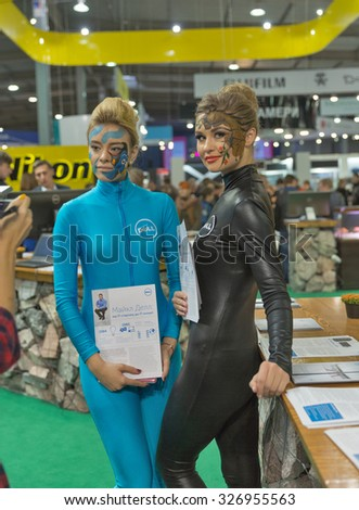 KIEV, UKRAINE - OCTOBER 11, 2015: Girls presenters work on Dell computers company booth during CEE 2015, the largest electronics trade show of Ukraine in ExpoPlaza Exhibition Center. - stock photo