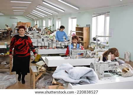 KIEV, UKRAINE - 6 October 2010: Workers at a garment factory - stock photo