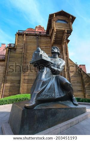 KIEV, UKRAINE - SEP 18, 2013: Monument to Yaroslav Mudry, Grand Duke of Novgorod and Kiev, holding Saint Sophia's Cathedral in his hands near Golden gate archaeological monument - stock photo