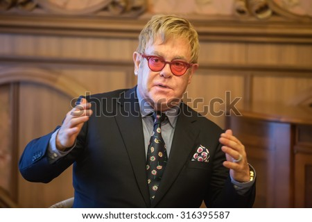 KIEV, UKRAINE - Sep 12, 2015: World-famous musician, composer and singer Elton John well-known in world for his charitable activity in fight against AIDS against his meeting with President of Ukraine - stock photo