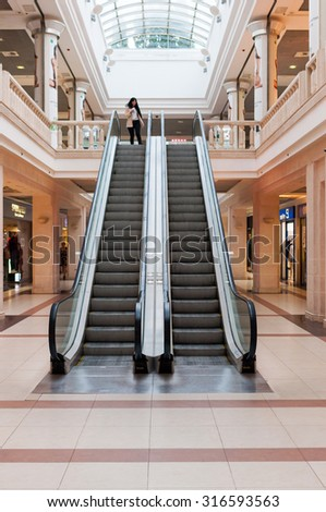 KIEV, UKRAINE - SEPTEMBER 14, 2015: Panoramic angle of escalator. Escalator at shopping mall or trade center. - stock photo