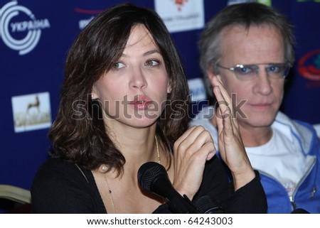 """KIEV, UKRAINE - SEPTEMBER 23: Sophie Marceau and Cristopher Lambert  arrive at the  press conference film """"L'homme de chevet""""  40th  Film Festival """"Molodist"""" on September 23, 2010 in Kiev, Ukraine - stock photo"""