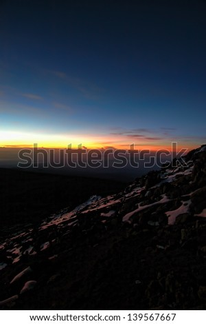 Kilimanjaro Summit Sunrise over the Clouds - stock photo