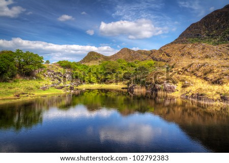 Killarney scenery with mountains reflected in lake, Ireland - stock photo