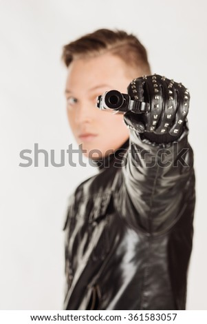 killer man aims his pistol. selectively focused on the front of the gun on white background - stock photo