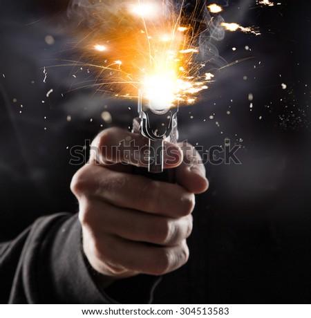 Killer with gun. - stock photo