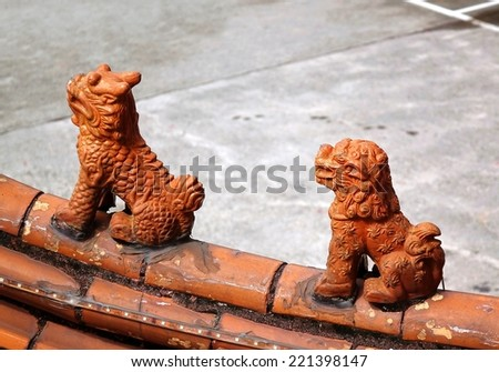 Kiln fired Chinese eave tiles decorated with mythological beasts - stock photo