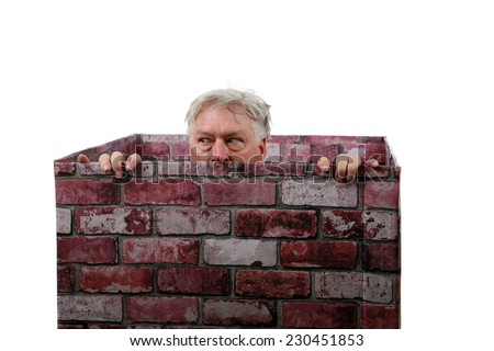 Kilroy was here. American popular culture expression that became popular during World War II. A man peeks out of a brick chimney showing only his face from his nose up and his fingers over the edges.  - stock photo