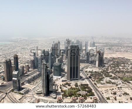 Kind from skyscraper Burj Khalifa on city. Place position in Dubai - stock photo