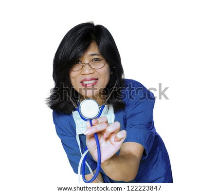 Kind nurse or doctor with stethoscope, ready to listen to heartbeat - stock photo