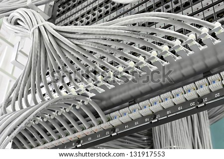 kind of wiring closet patch panels with 6-th category in the background - stock photo