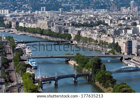 Kind on the river Seine with three bridges, Paris, France - stock photo