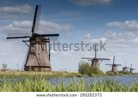 Kinderdijk Netherlands May 2015, old windmills standing in a typical Dutch landscape - stock photo