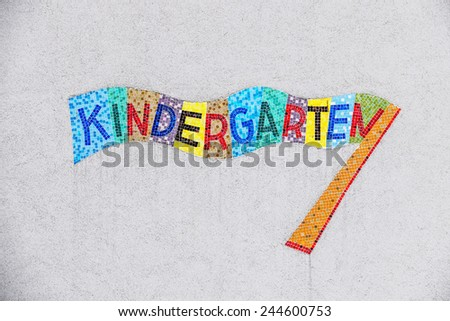 kindergarten colorful sign, symbol for child care and child-friendliness - stock photo