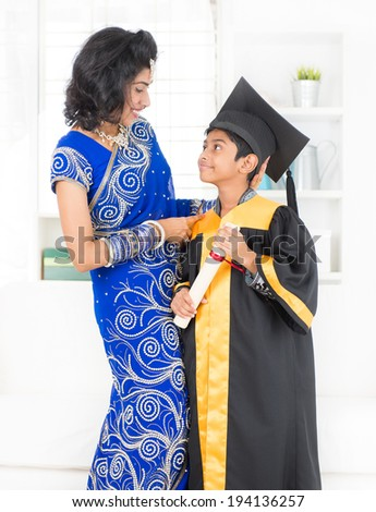 Kindergarten graduation. Asian family, Indian mother and son on kinder graduate day. - stock photo