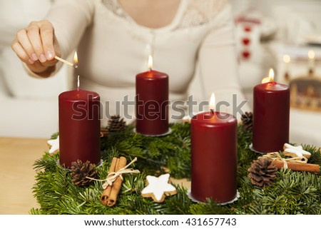 Kindle first candle on the fourth Advent - stock photo