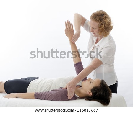 Kinesiologist or physiotherapist treating Pectoralis major - stock photo