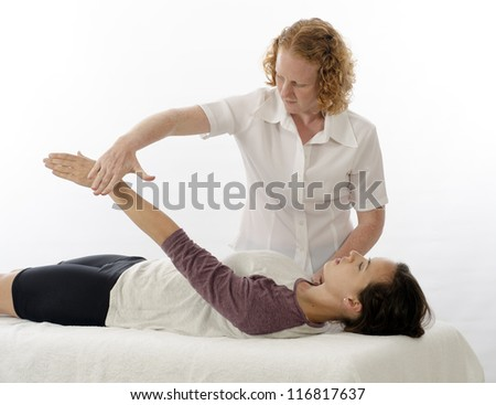 Kinesiologist or physiotherapist treating Supraspinatus - stock photo