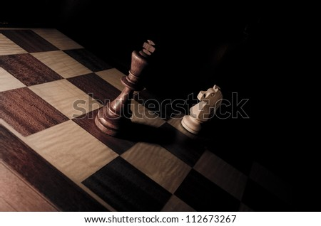 King and Knight in chessboard - stock photo