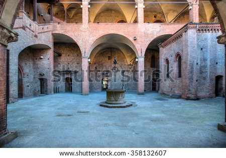 King Enzo palace courtyard and well, Bologna ?taly - stock photo