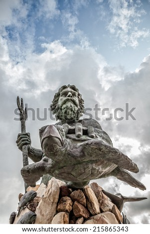 King Neptune statue on the boardwalk of Virginia Beach on a cloudy day - stock photo