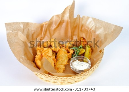 King prawns in batter with fried potatoes on a plate.  - stock photo