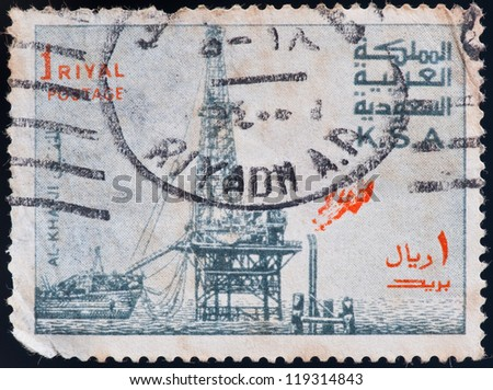 KINGDOM OF SAUDIARABIA - CIRCA 1976: a stamp printed by Kingdom of Saudi Arabia, shows a ship in the ocean, circa 1976 - stock photo