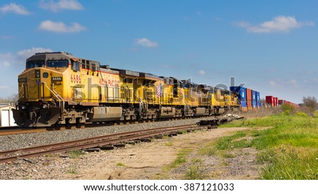 KINGSBURY, TEXAS � FEBRUARY 19 2016: A 5 engine Union Pacific railroad train at rest - stock photo