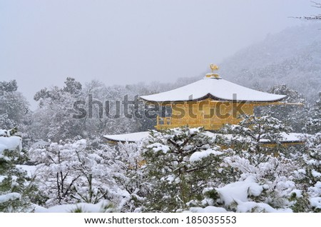 Kinkakuji in Kyoto, Japan during light snow.  - stock photo