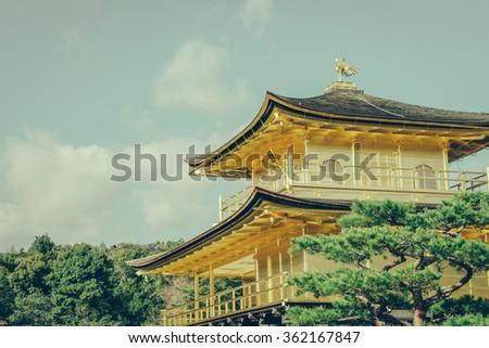 "Kinkakuji Temple "" The Golden Pavilion"" in Kyoto, Japan ( Filtered image processed vintage effect. ) - stock photo"