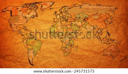 kirgistan flag on old vintage world map with national borders - stock photo