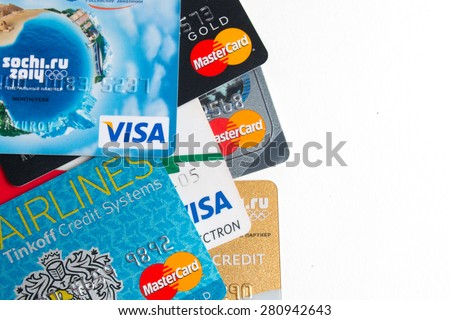 KIROV, RUSSIA - MAY 24, 2015: Photo of VISA and Mastercard credit card with USA dollars bills on white background - stock photo