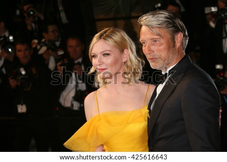 Kirsten Dunst attends the screening of 'The Neon Demon' at the annual 69th Cannes Film Festival at Palais des Festivals on May 20, 2016 in Cannes, France. - stock photo