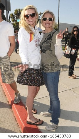 Kirsten Dunst, Kristen Bell at Invisible Children's Global Event The Rescue, Santa Monica Pier to City Hall, Los Angeles, CA April 25, 2009 - stock photo
