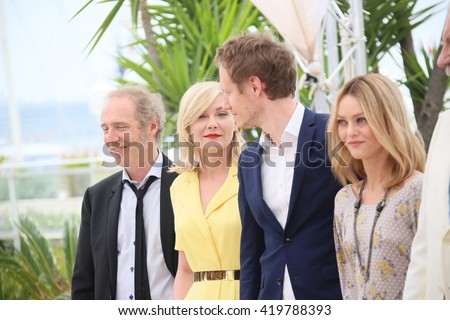 Kirsten Dunst, Vanessa Paradis attends the jury photocall during the 69th annual Cannes Film Festival at Palais des Festivals on May 11, 2016 in Cannes, France. - stock photo