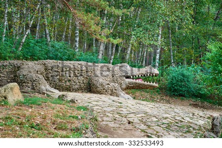 Kislovodsk, Russia - SEPTEMBER 08, 2015: Statue of stone crocodile in the park of city Kislovodsk located on Northern foothills of Greater Caucasus.    - stock photo