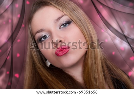 kiss of a beautiful young woman. Valentine. - stock photo