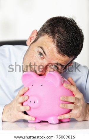 kiss piggy bank - stock photo
