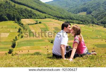 kissing couple in mountain Carpathians - stock photo