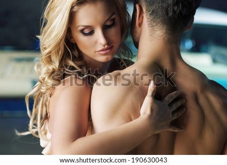 Kissing couple portrait - stock photo