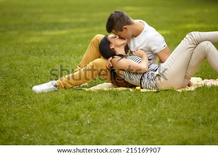 Kissing couple. Portrait of young caucasian couple kissing - stock photo