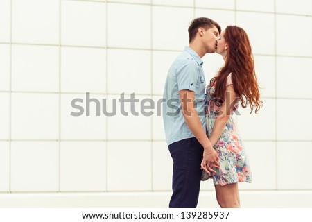 kissing young couple. romantic family portrait - stock photo