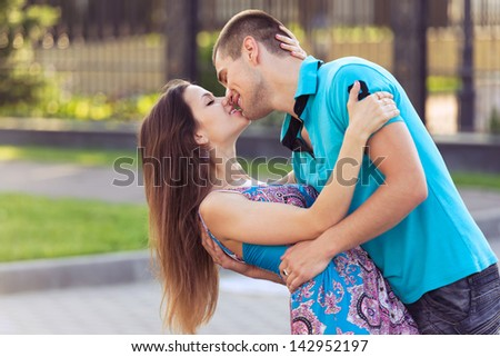 kissing young family. happy moments of life - stock photo