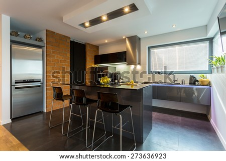 Kitchen and dining area in modern apartment - stock photo